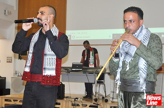 0292 Singer Ibrahim Ashour accompanied by yarghoul player Moussa Zbidat with (in background) keyboard player Ahmed Aburezeq