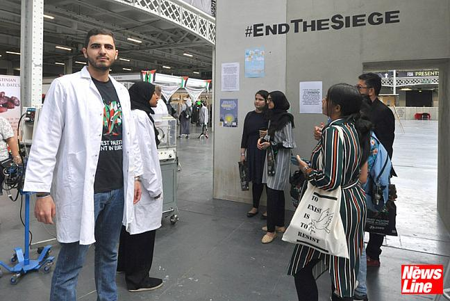 008  DR ABEEN BASHAR (left) and nurse FATMA SHARIF explain to visitors the problems for those in Palestine living under the siege