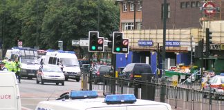 Huge police presence outside Stockwell tube station in south London yesterday after the police shoot