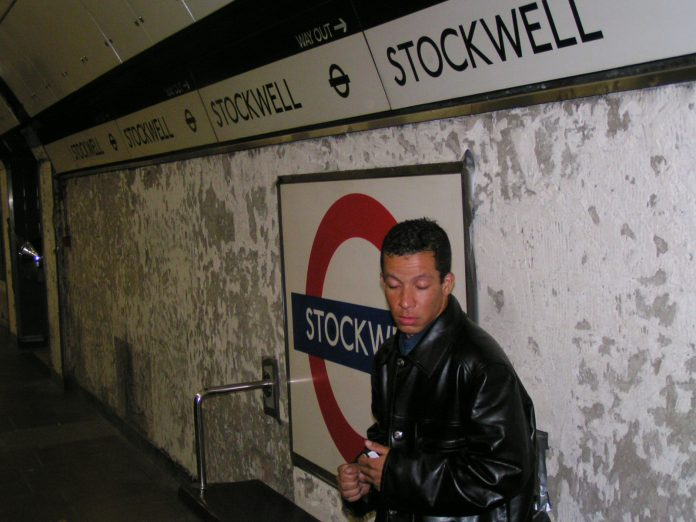 Alex Alessandro Pereira, cousin of Jean Charles de Menezes grieves on the platform at Stockwell Tube station on Sunday 24th July two days after his cousin was murdered by police