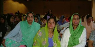 A section of the strikers from Gate Gourmet listening to a report from Tony Woodley on Monday afternoon in Southall