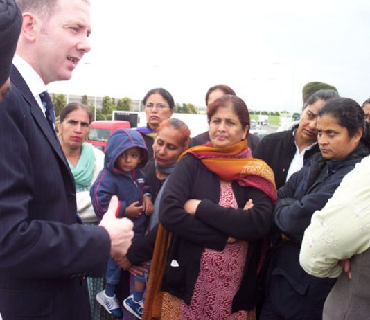 TGWU official OLIVER RICHARDSON being confronted by Gate Gourmet pickets yesterday morning who want their jobs back