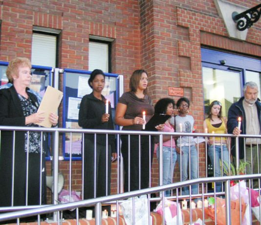 Friends and family of Paul Coker outside Plumstead police station on Tuesday evening – one month after he died. A minute's silence was held as a mark of respect
