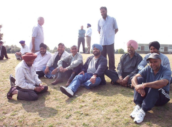 The striking Gate Gourmet workers fighting for reinstatement relaxing at the weekend. All except six pickets are being kept on a grass verge by a roundabout near to the factory
