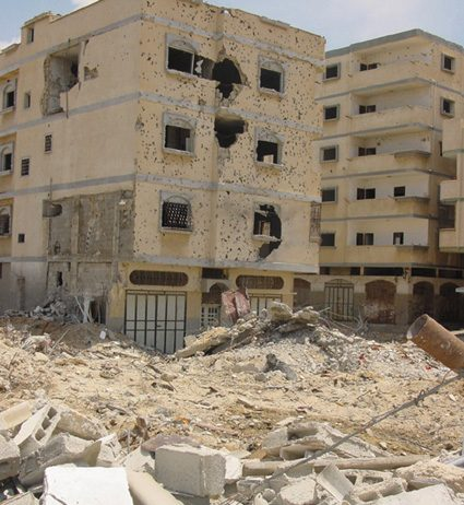 Palestinian flats in Rafah full of shell and bullet holes because of Israeli army shelling