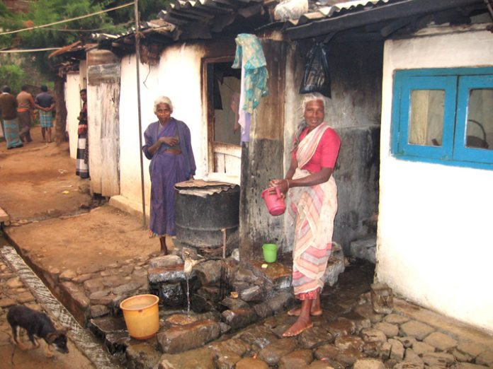 Living conditions could not be more primitive on the Eskdale estate with women cooking outside their one storey shacks next to an open drain