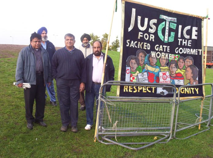 Locked-out Gate Gourmet workers picketing yesterday morning on the hill near the factory