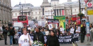 Paul Coker's mother PATRICIA, UFFC Chair BRENDA WEINBERG and PATRICIA DA SILVA-ARMANI leading the march down Whitehall