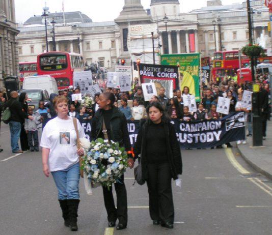 Paul Coker's mother PATRICIA, UFFC Chair BRENDA WEINBERG and PATRICIA DA SILVA-ARMANI leading the march down Whitehall