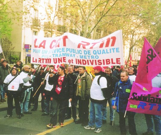 Marseilles transport workers against the privatisation of bus, tram and metro services in the city at the front of the Saturday's Paris demonstration