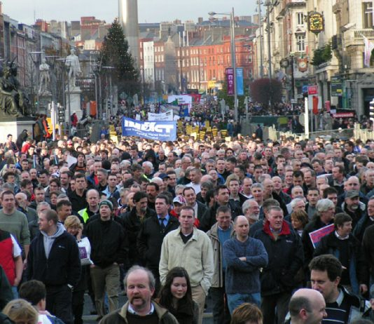 Over 100,000 workers marched through Dublin's streets yesterday as the general strike shook the country in protest at slave labour being used on Irish Ferries