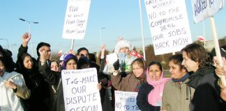 Locked-out Gate Gourmet workers in high spirits welcomed Father Christmas at their mass picket yesterday