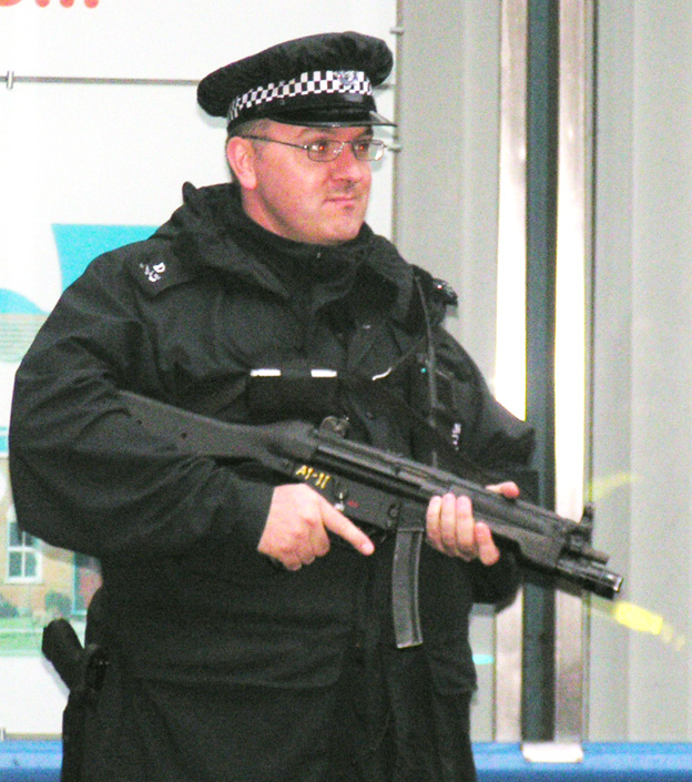 Armed policeman in central London