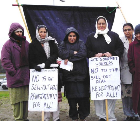 Locked-out Gate Gourmet workers on the picket line at the Beacon roundabout near the factory yesterday midday