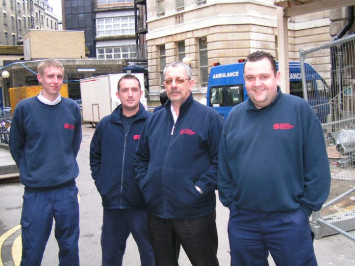 CHRIS KAVANAGH (right) with fellow fire alarm engineers, they called for the TUC to act to defend the NHS