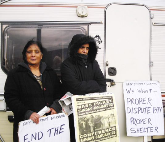 Gate Gourmet locked-out workers outside their  caravan at Heathrow yesterday