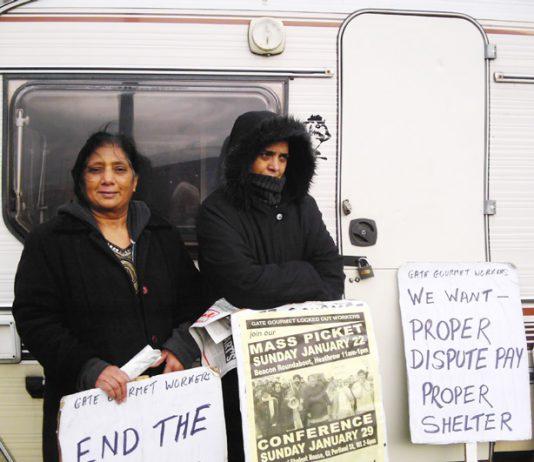 Gate Gourmet locked-out workers outside their  caravan at Heathrow yesterday