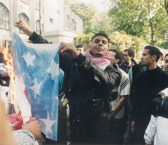 Youth in London burning the US flag in October 2001 after the war on Afghanistan began