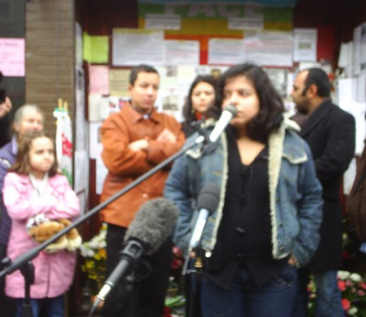 PATRICA DA SILVA ARMANI (speaking), ALEX PERIERA and VIVIEN MENEZES FIGUEIREDO (behind), cousins of Jean Charles de Menezes at the Stockwell Tube vigil six months after he was shot dead by police