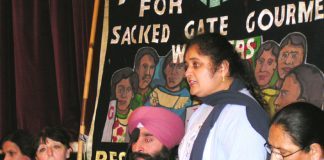 Gate Gourmet locked-out worker PARMJIT BAINS , flanked by HARBINDER SINGH and LAKHINDER SARAN  addressing the News Line- locked-out Gate Gourmet workers Conference in central London last Sunday