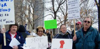 UAW car workers fighting to defend their jobs and pensions lobbying the Detroit motor show