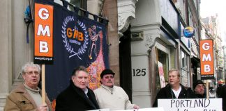 GMB members with their acting General Secretary PAUL KENNY (2nd left) demonstrating outside Portland PR in Holborn yesterday