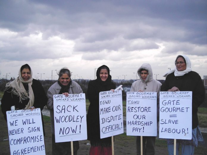 Determined Gate Gourmet locked out workers brave the cold weather yesterday on the picket line at Heathrow