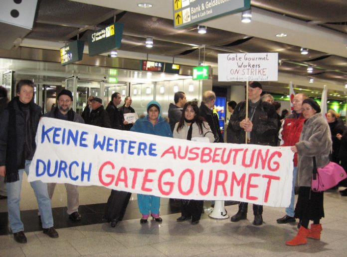 Two Gate Gourmet  locked-out workers from London's Heathrow airport were given a warm reception at Dusseldorf airport on Wednesday when they visited striking local Gate Gourmet workers