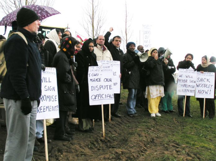 Locked-out Gate Gourmet workers and their supporters held out placards and shouted slogans during their successful picket at Heathrow yesterday