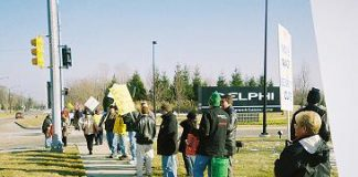 Delphi workers demonstrate outside one of Delphi's factories