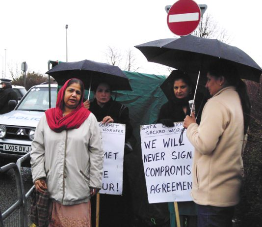 Gate Gourmet locked-out workers picketing the factory yesterday – threatened with arrest by Heathrow Airport police