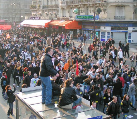 Huge crowds are cheered on their way to Place de la Nation on Saturday March 18 where they were confronted by squads of CRS riot police who mounted baton charges at workers and youth standing in the central reservation