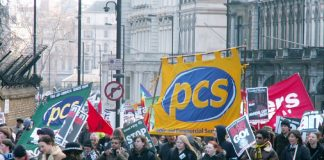 PCS  banners on last Saturday's march to mark the third anniversary of the war on Iraq