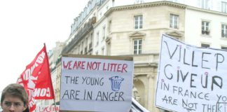 French youth with placards made by English language students marching through Paris on Thursday March 16