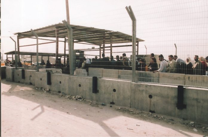 Palestinians queue at the Qalandiya Israeli army checkpoint on the outskirts of Ramallah – Israel now declare it to be a frontier post