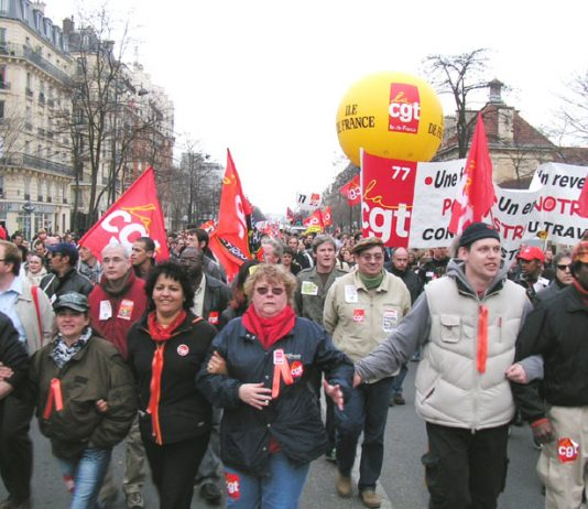 Members of the CGT, France's largest trade union federation, arrive at Place d'Italie at the end of Tuesday's demonstration
