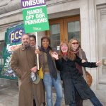 Striking local government workers on March 28 determined to defend their pensions