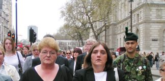 ROSE GENTLE (centre, right) leading the group from Military Families Against the War to the Cenotaph