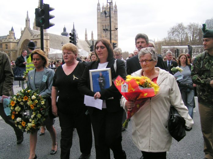 Rose Gentle (holding photograph) leads the Military Families Against the War march  from Parliament to Downing Street on Wednesday