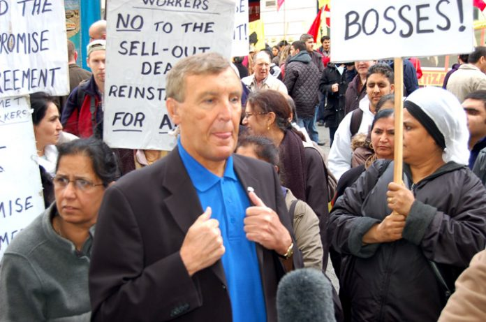 TGWU leader TONY WOODLEY is confronted by the locked-out Gate Gourmet workers at the start of Monday's May Day march