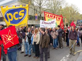 PCS banner on the May Day demonstration in London – PCS members were on strike last week against thousands of job cuts engineered by Brown