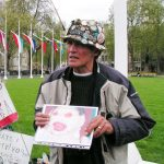 Brian Haw holding the photograph of an infant victim of the continuing war in Afghanistan – the baby was one of triplets