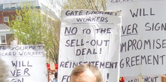 TGWU leader TONY WOODLEY surrounded by locked out Gate Gourmet workers at the May Day demonstration in London