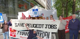 French and British workers with the CGT and TGWU/Amicus banners deliver a clear message to Peugeot shareholders