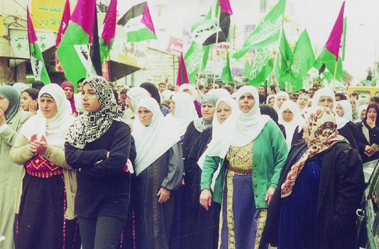Hamas and Palestinian flags at a funeral in Ramallah for youth killed by the Israeli occupation forces