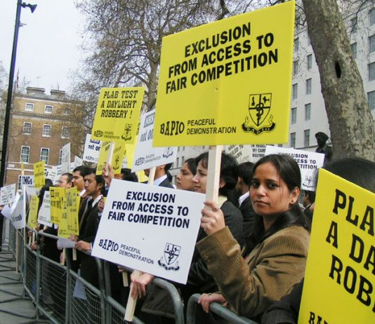 Indian NHS doctors demonstrating against the Labour Government's policy that is taking away their jobs