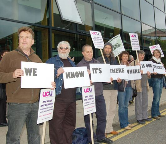 Lecturers with a clear message as the march assembles outside South Bank University