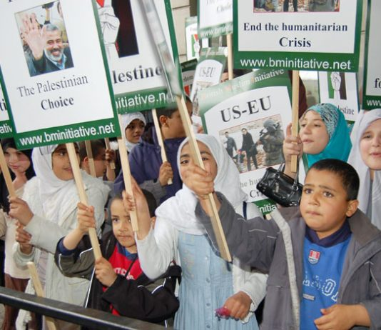 Children on the May 20th London 'Stop Starving the Palestinians' demonstration with placards supporting the Hamas victory in the elections