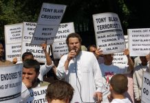 Demonstrators in Forest Gate denounce Blair as the terrorist and demand the police apologise for the raid on a local working class family