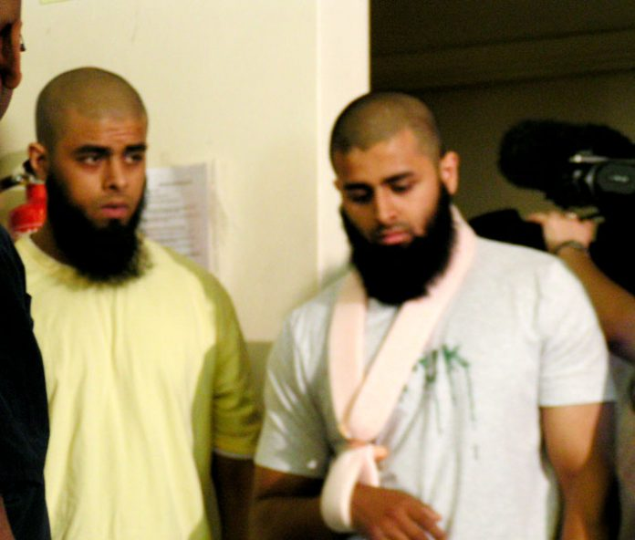 ABUL KOYAIR and his wounded brother MOHAMMED ABDUL KAHAR after giving a press conference in Forest Gate yesterday